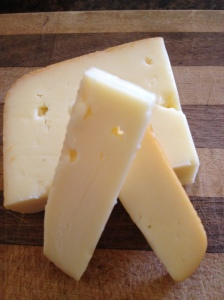 Semi-soft, creamy, blended cheese.