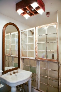 I found this project in a backissue of Domino-- buy salvaged windows for pennies on the dollar at your local architectural salvage.